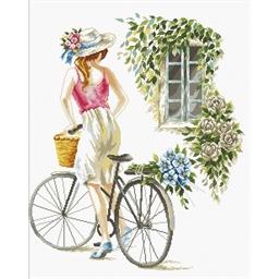 Kit point de croix La jeune fille à vélo